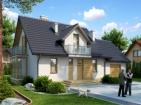 Проект уютного дома с гаражом и мансардой